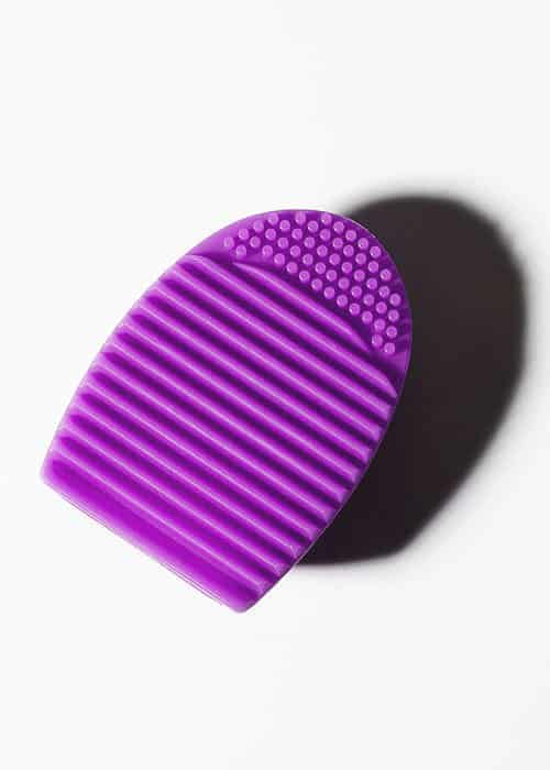 brush cleaning egg purple