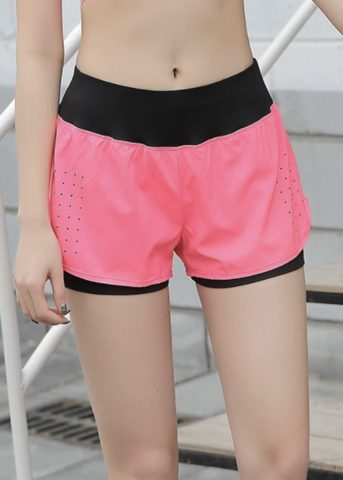 Quick pocket womens sports shorts pink front